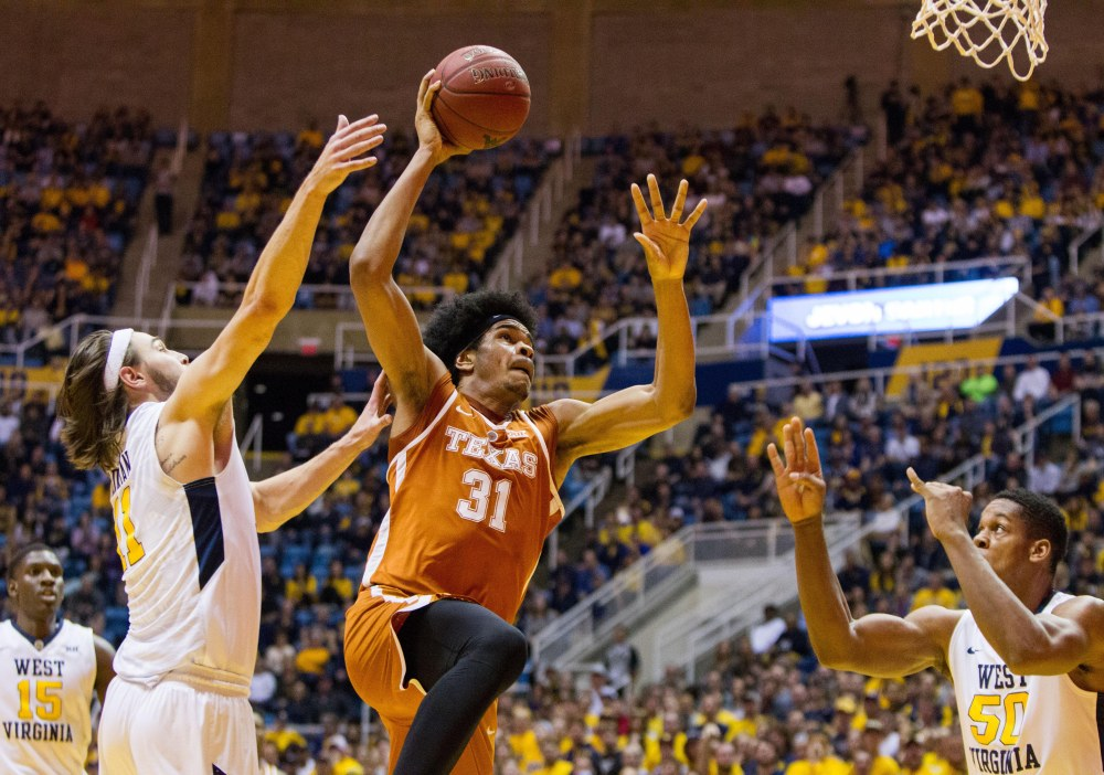 9890353-ncaa-basketball-texas-at-west-virginia